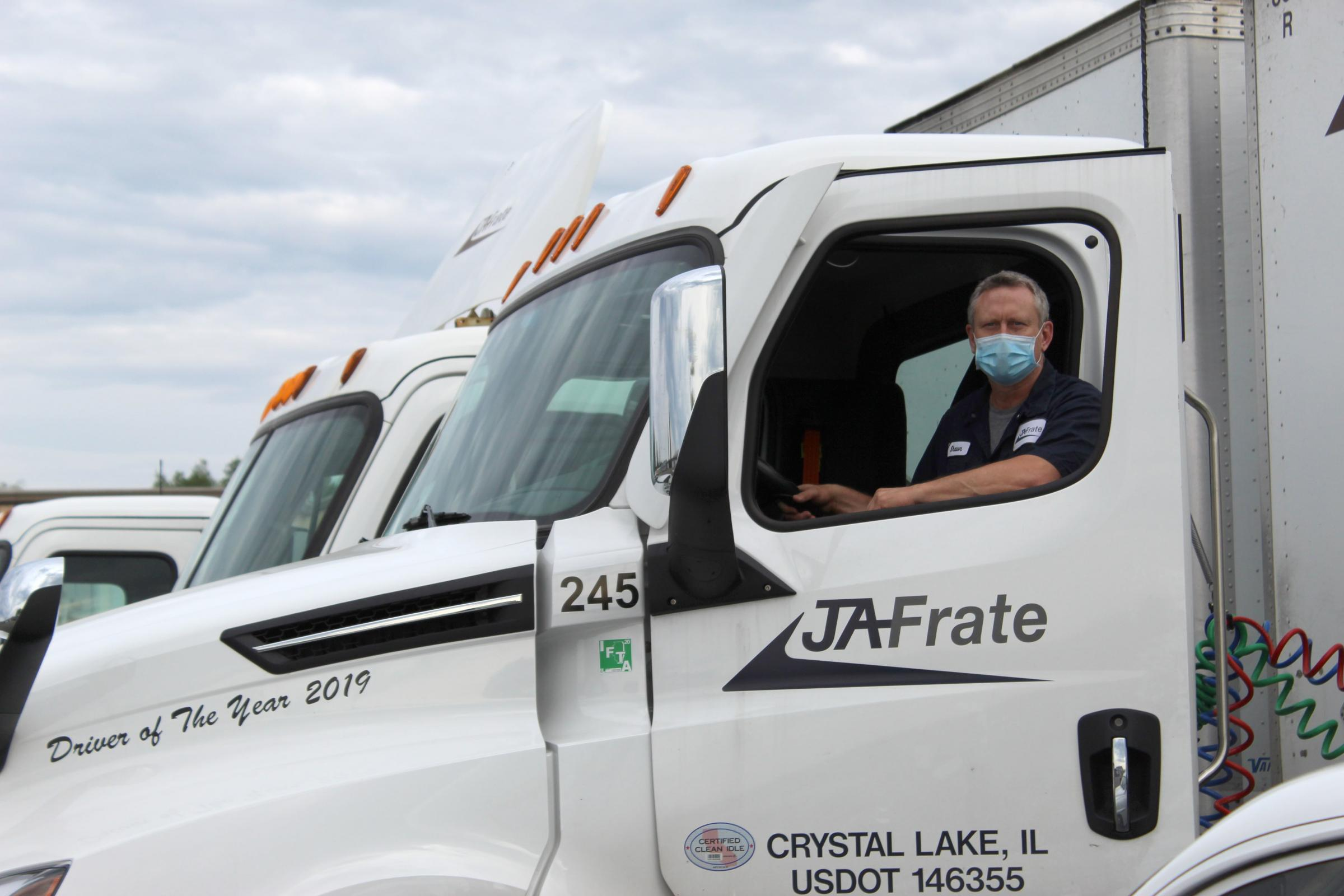 Illinois truck driver at JA Frate wearing a mask in his truck